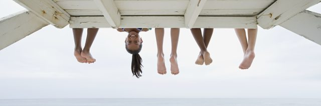 Girl upside down on a dock