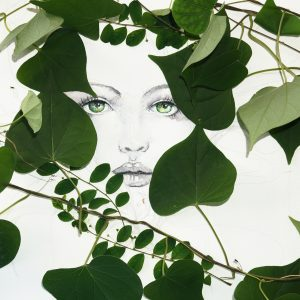 Drawn watercolor of woman face decorated with real green leaves. Perfect image as birthday card.