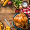 thanksgiving dinner turkey on wooden plank table