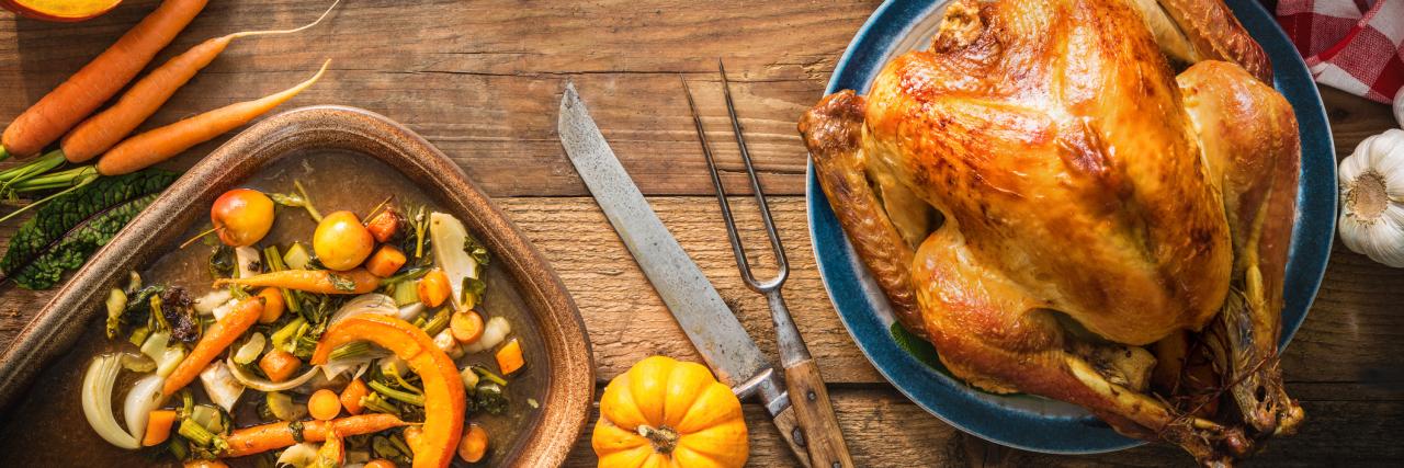 thanksgiving dinner turkey on wooden plank table