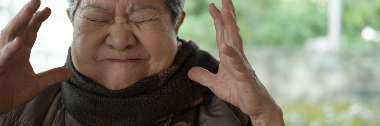 portrait of furious elder woman, enraged elderly female, angry asian senior