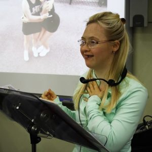 Grace, woman with Down syndrome, giving speech at a school