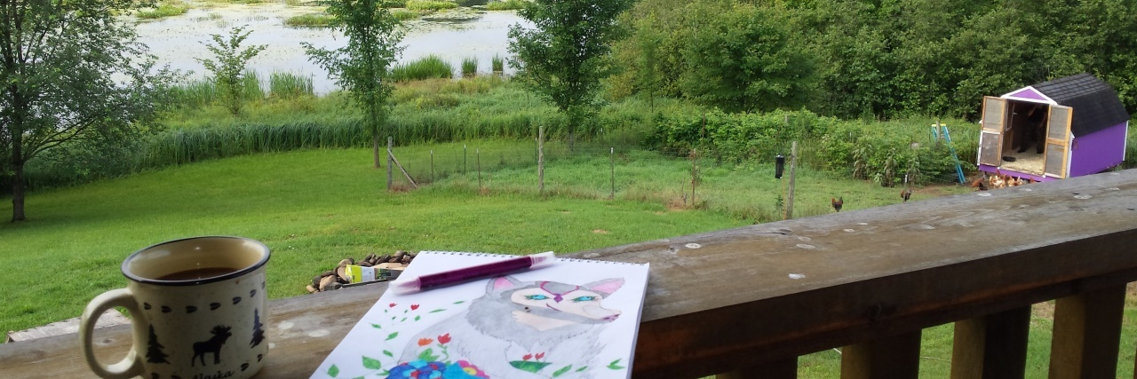 woman's backyard with art and coffee on the railing of her deck