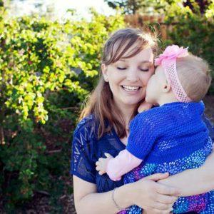 Katie holding Olivia Caldwell