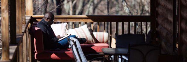 Lamar Hendricks Reading on porch