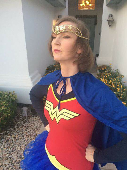 woman dressed as superhero
