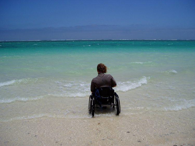 Kev in his wheelchair at the beach.
