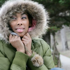 Portrait of young African American woman in fur hooded coat.