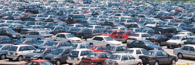 Busy parking lot full of cars.