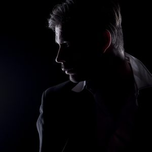 A man's silhouette.