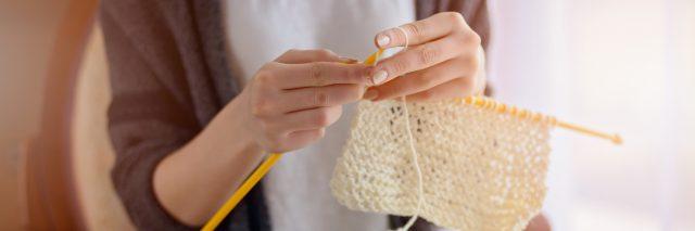 A close-up of a woman knitting.