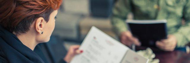 A young woman looking at a menu.