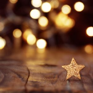 Christmas background with stars and bokeh