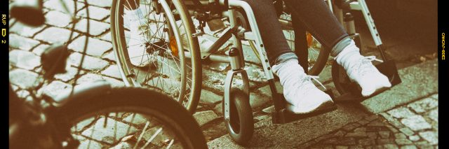 Woman in wheelchair on the street.