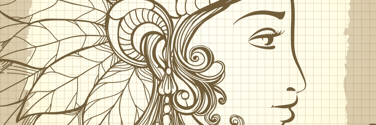 A decorative design of a woman's facial profile.