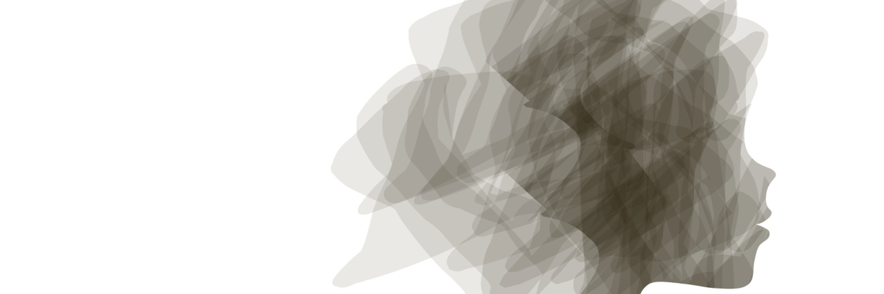 A silhouette image of a woman's head.