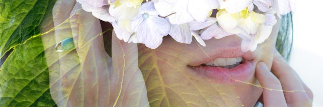 woman with flowers over her face