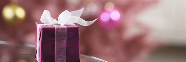 Small pink gift box on edge of table.
