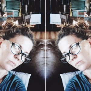 mirror images of a woman wearing glasses and lying on her couch