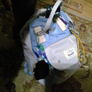 woman's backpack filled with essentials for managing dysautonomia