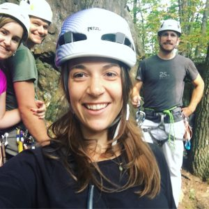 selfie of woman with three of her friends as they rock climb