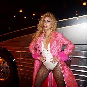 lady gaga posing in a long pink coat