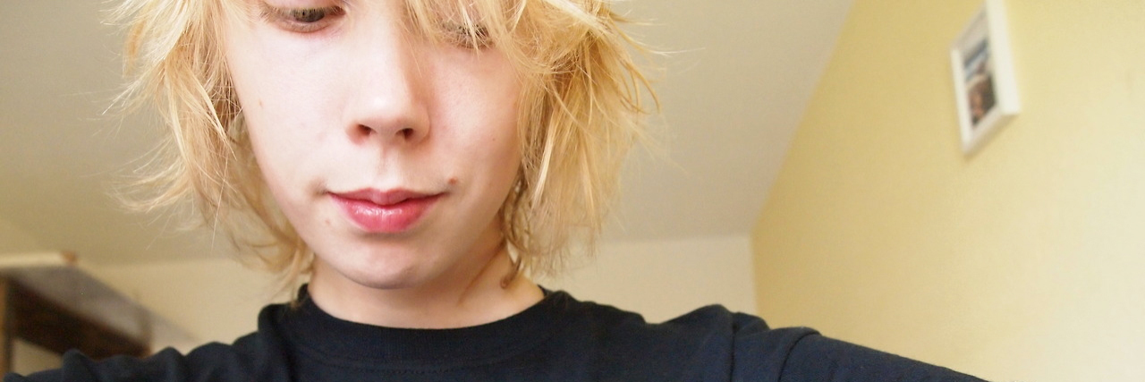 young blonde woman selfie wearing ok to not be ok t-shirt