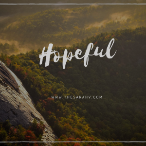 picture of mountains with the word 'hopeful'