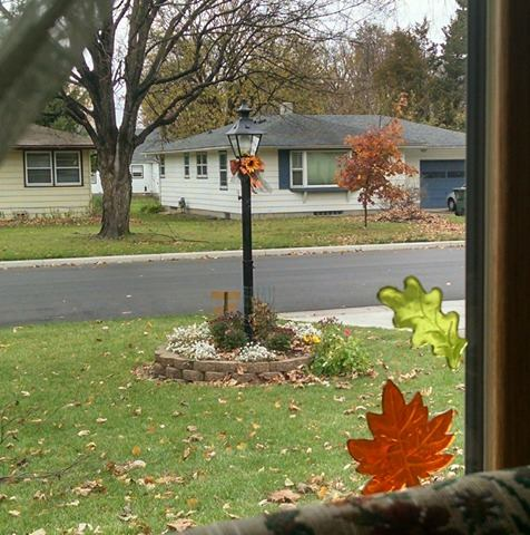 A view outside the writer's window, showing her lamp post and front yard.
