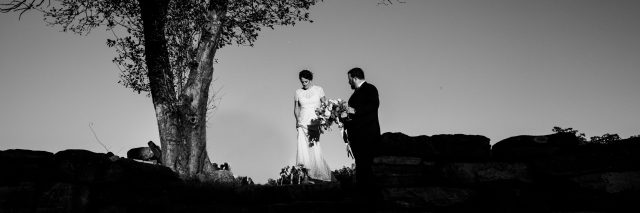 black and white photo married couple wedding beside tree