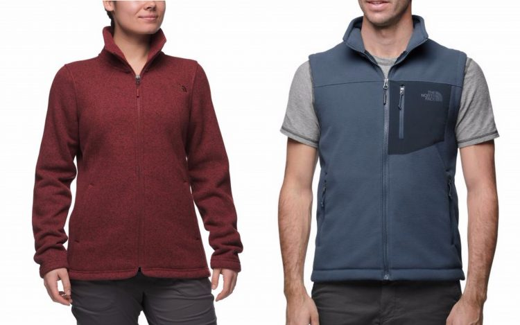 north face red women's jacket and blue men's vest
