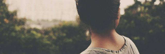 faded photo of young woman looking off into distance