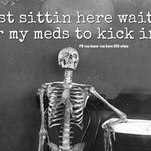 skeleton sitting at table with text just sitting here waiting for my meds to kick in