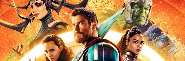 """image of movie poster for """"Thor: Ragnarok."""" Thor stands in front with other characters behind him"""