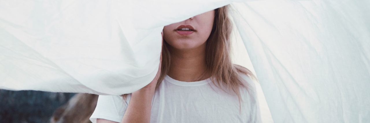 woman sheet over eyes