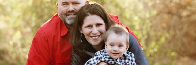 The Roberts Family. Mom in wheelchair, husband and baby boy.