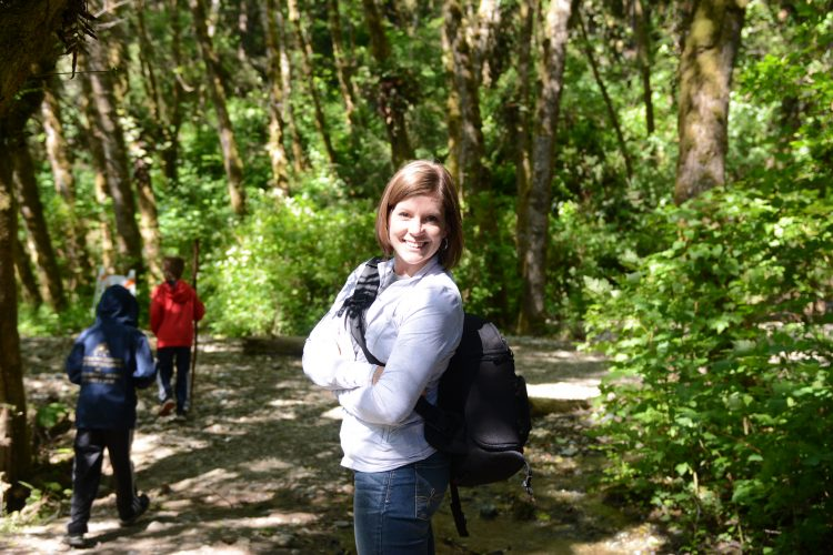 Mel Gunnell hiking in woods