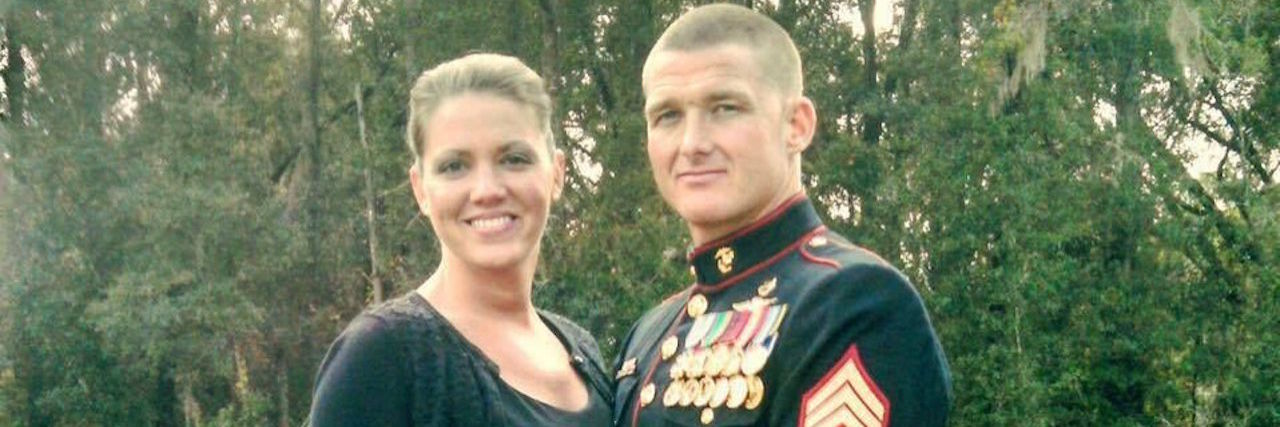 wife and husband who is an active military member stand side by side