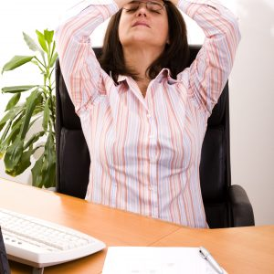 businesswoman at her office stressed with her work