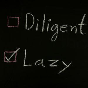 lazy written on a blackboard