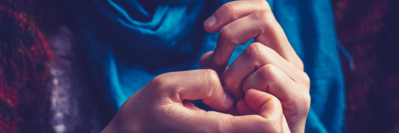 close up of woman picking skin around nails