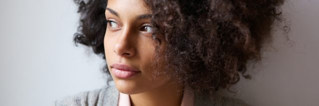 woman looking away in thought