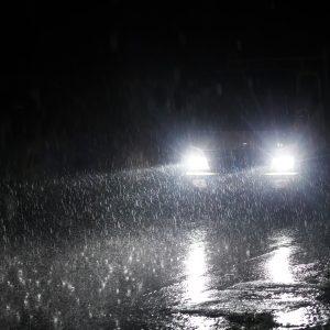 Bright headlights on a rainy night.