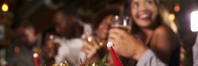 Christmas party at a bar, focus on foreground decorations