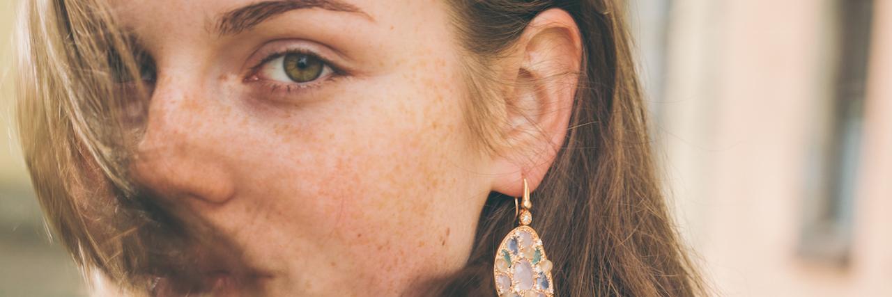 Beautiful woman face portrait freckles street city fashion nature