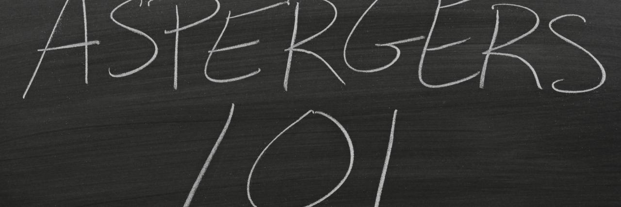 """The words """"Aspergers 101"""" on a blackboard in chalk"""