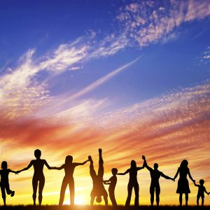 Happy group of diverse people together hand in hand.