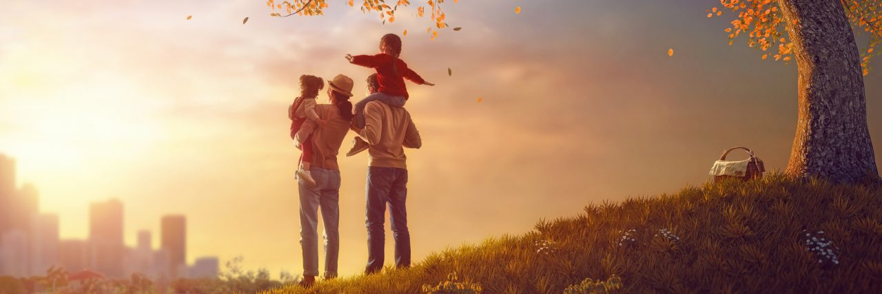 Happy family at sunset. Father, mother and two children.