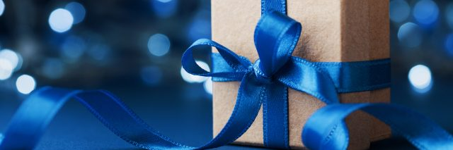 gift wrapped in blue ribbon