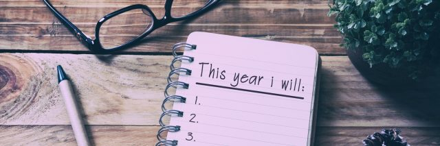 journal with a checklist of things to do this year